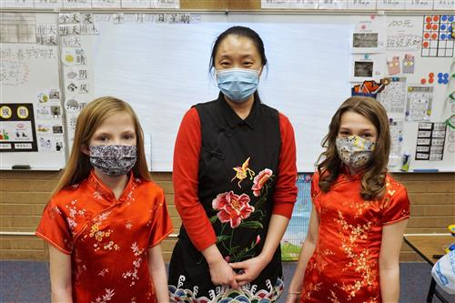 Teacher and students dressed to celebrate Chinese New Year