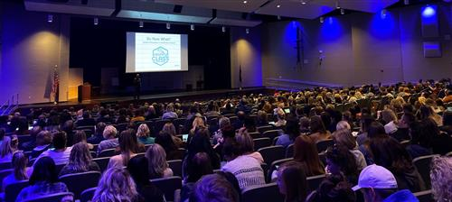 Elementary educators in an auditorium listening to Ben Springer