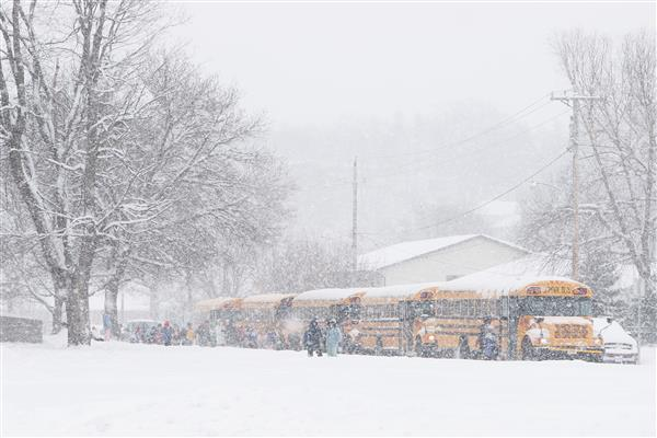 School busses in snowstorm