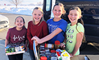 students with food drive donation