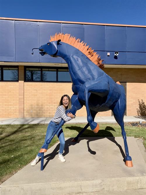 Keila Molina by the Mountain Crest mustang statue